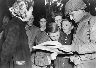 Inhabitants of Cherboug with an American Officer (June 1944)