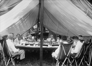 Thomas Edison, U.S. President Warren Harding, Henry Ford, and Families Having Lunch under Tent at Campsite, Maryland, USA, Harris & Ewing, 1921