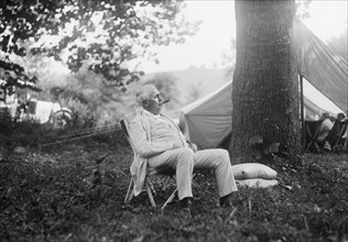 Thomas Edison, Seated Portrait while Smoking Cigar at Campsite, Maryland, USA, Harris & Ewing, 1921