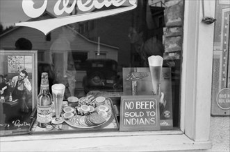 """Sign in Beer Parlor Window, """"No Beer Sold to Indians"""", Sisseton, South Dakota, USA, John Vachon, Farm Security Administration, September 1939"""