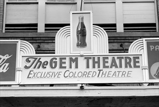 """Sign Above Moving Picture Theater, """"Exclusive Colored Theatre"""", Waco, Texas, USA, Russell Lee, Farm Security Administration, November 1939"""