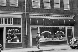 """Café with Two Entrances Marked """"White"""" and """"Colored"""", Durham, North Carolina, USA, Jack Delano, Office of War Information, May 1940"""