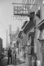 """Hotel Clark with Sign """"The Best Service for Colored Only"""", Beale Street Lined with Pawn Shops and Secondhand Clothing Stores, Memphis, Tennessee, USA, Marion Post Wolcott, Farm Security Administration..."""