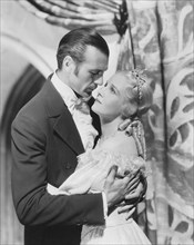 """Gary Cooper and Ann Harding, on-set of the Film, """"Peter Ibbetson"""" directed by Henry Hathaway, 1935"""