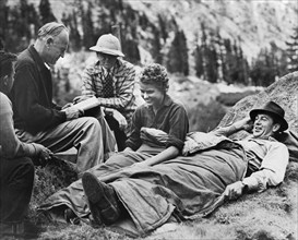 """Director Sam Wood, Cinematographer Ray Rennahan, Ingrid Bergman, Gary Cooper on-set of the Film, """"For Whom the Bell Tolls"""", 1943"""