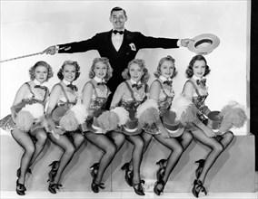 "Virginia Grey, Lorraine Krueger, Joan Marsh, Clark Gable, Virginia Dale, Paula Stone, Bernadene Stromberg, Publicity Portrait for the Film, ""Idiot's Delight"", 1939"
