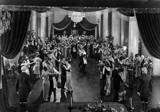"Mae Murray, John Gilbert, (center), Clark Gable, (as an extra, below right-hand canopy post), on-set of the silent film, ""The Merry Widow"", 1925"