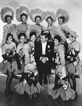 "Clark Gable and chorus girls, on-set of the Film ""San Francisco"", 1936"