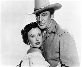"""Phyllis Thaxter, Gary Cooper, on-set of the Film """"Springfield Rifle"""", 1952"""