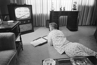 Pajama-clad Boy being Educated via Television during period that Schools were Closed to Avoid Integration, Little Rock, Arkansas, USA, photograph by Thomas J. O'Halloran, September 1958