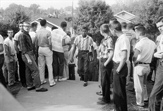 African American Boy Walking through Crowd of White Boys during Period of Violence Related to School Integration, Clinton, Tennessee, USA, photograph by Thomas J. O'Halloran, September 1956