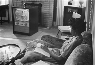 African-American High School Girl being Educated via Television during period that Schools were Closed to Avoid Integration, Little Rock, Arkansas, USA, photograph by Thomas J. O'Halloran, September 1...