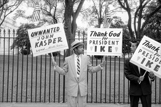 Two Men Protesting John Kasper, an American far-right activist and Ku Klux Klan member who took a militant stand against racial integration during the civil rights movement, Washington, D.C., USA, pho...