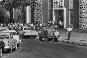 Students and Soldiers in Military Vehicle outside of buildings during Integration of University of Mississippi, Oxford, Mississippi, USA, photograph by Marion S. Trikosko, October 4, 1962
