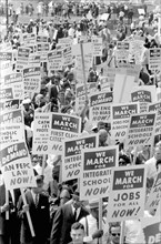 Demonstrators marching in Street holding Signs during March on Washington for Jobs and Freedom, Washington, D.C., USA, photograph by Marion S. Trikosko, August 28, 1963