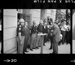 Governor George Wallace attempting to block Integration by standing defiantly at Door while being confronted by Deputy U.S. Attorney General Nicholas Katzenbach, University of Alabama, Tuscaloosa, Ala...