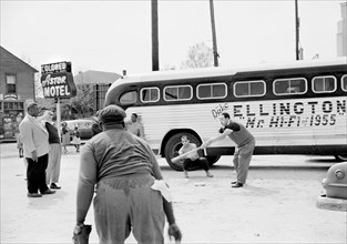 Duke Ellington and Band Members playing Baseball in front of their Segregated Motel while touring, Florida