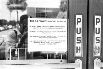 Racist Sign on Restaurant Door, Albany