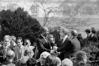 U.S. President Jimmy Carter shaking hands with Egyptian President Anwar Sadat and Israeli Prime Minister Menachem Begin at signing of Egyptian-Israeli Peace Treaty, White House