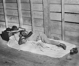 man, migrant worker, sleeping, agriculture, historical,