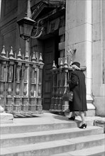 Woman entering the church of St Martin in the Fields, London, c1950