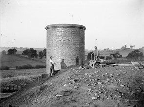 Construction workers near a ventilation chimney at Charwelton, Northamptonshire, c1873-c1923