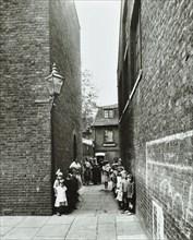 Children in an alleyway, Upper Ground Place, Southwark, London, 1923.  Artist: Unknown.