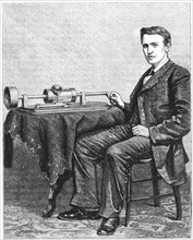 Thomas Alva Edison, American inventor, with an early hand-driven model of his phonograph, 1878. Artist: Unknown