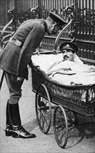 George V with a wounded soldier, 7th Battalion Sherwood Foresters, March 1918. Artist: Unknown