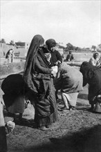 Women collecting water at on the Tigris River, Baghdad, Iraq, 1917-1919. Artist: Unknown