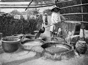 Clarifying sugar cane juce, Annam, Vietnam, 1922. Artist: Unknown