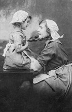 Mother and daughter, early 20th century. Artist: Unknown