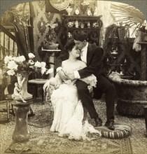 'George Greatly Admires Ethel's Beautiful Complexion'.Artist: Underwood & Underwood