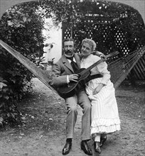 'The Musical Pair in the Hammock'.Artist: American Stereoscopic Company