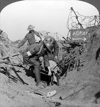 Carrying a wounded soldier to a first aid post, Passchendaele, Belgium, World War I, 1914-1918.Artist: Realistic Travels Publishers