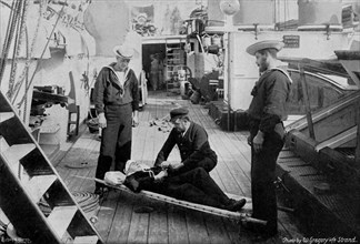 Ambulance drill on board the cruiser HMS 'Tartar', 1896.Artist: W Gregory