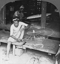 Boys making the native umbrella, Burma, 1908. Artist: Stereo Travel Co