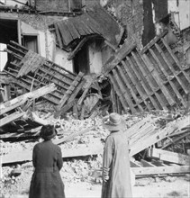 House destroyed by a bomb, Armentières, France, World War I, c1914-c1918. Artist: Nightingale & Co