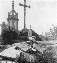 Damaged graves, old communal cemetery, Ypres, Belgium, World War I, c1914-c1918. Artist: Nightingale & Co