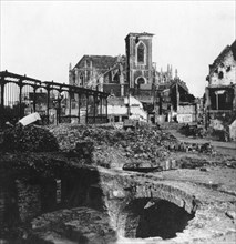 Damaged exterior of the Church of St Vaast, Armentières, France, World War I, c1914-c1918 Artist: Nightingale & Co