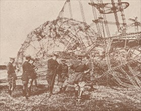 British staff officers examining the wreckage of a Zeppelin brought down in England, c1917 (1919). Artist: Unknown.