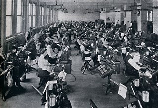 'A View of the Largest Battery of Composing Machines in the World', 1916. Artist: Unknown.