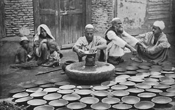 Kashmiri potters at work, 1902. Artist: Bourne & Shepherd.