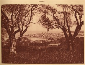 'View through the olives-trees to Antibes', 1930. Creator: Unknown.