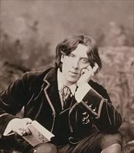Oscar Wilde, Irish born playwright and wit, 1882. Artist: Unknown
