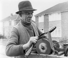 Gypsy knife-grinder, Horley, Surrey, 1964.