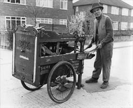 Gipsy knife-grinder with his handcart, Horley, Surrey, 1964.