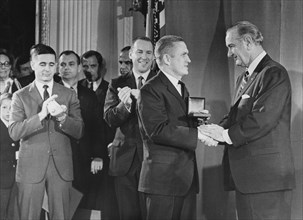 Apollo 8 astronauts receive distinguished service medals from President Johnson, January 1969. Artist: Unknown