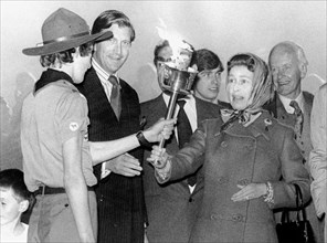 Queen Elizabeth II is handed a torch to light a bonfire with, Snow Hill, Windsor Great Park, 1977. Artist: Unknown