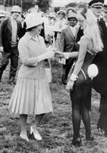 The Queen talks to a Bunny Girl, Derby Day, Epsom, 1978. Artist: Unknown